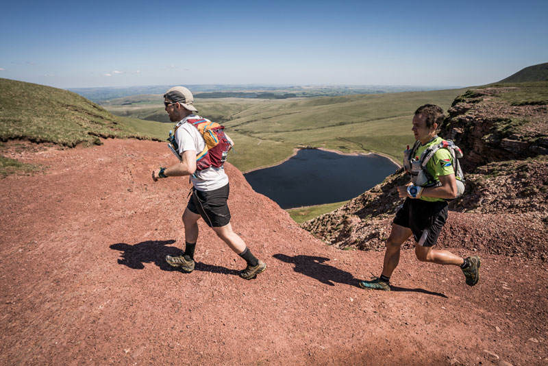 6 Two runners toil in the heat on day five of the Berghaus Dragons Back Race photo Ciancorless