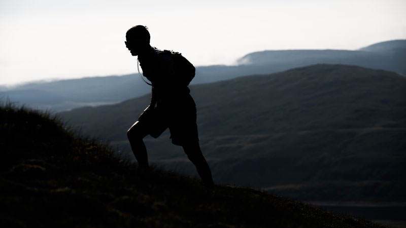 7 A runner in silhouette on day three of the Berghaus Dragons Back Race photo Ciancorless
