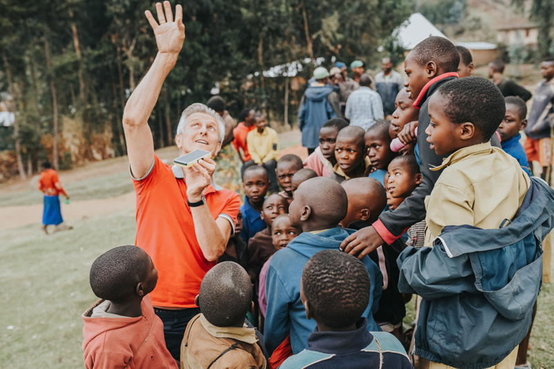 WakaWaka founder and CEO Maurits Groen explainins how solar energy works to children in Rwanda 002
