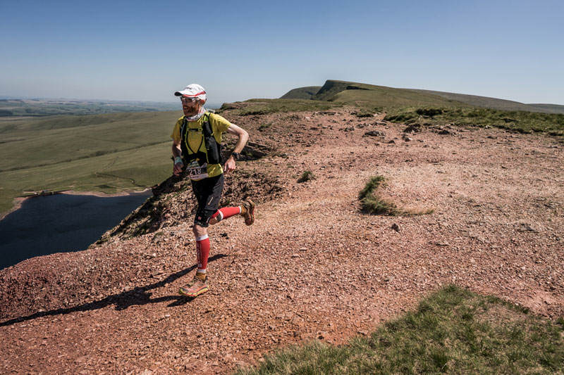 2 Marcus Scotney strides out on day five of the Berghaus Dragons Back Race photo Ciancorless